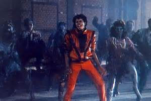 Michael Jackson dances during the 1983 film clip to his ...