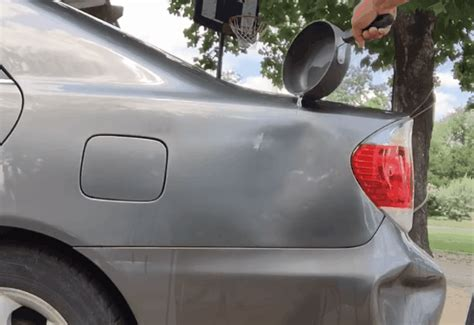 How To Fix Dent In Car Door by Fixing A Dent With Water Does This Car Hack Really