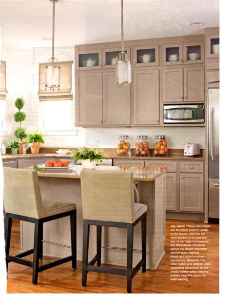taupe colored kitchen cabinets frosted glass top cabinets pendants island table