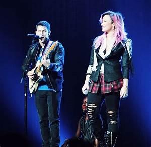 Nick Jonas Joins Demi Lovato On Stage At 1st Neon Lights ...