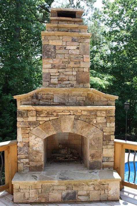 Outdoor Stone Fireplace On Wood Deck  Pool Heaters In
