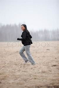 Pregnant woman running in the field | Stock Photo | Colourbox