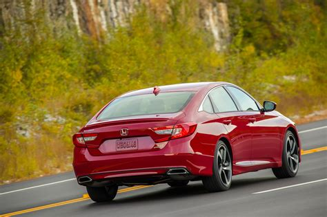 The honda accord sport 2.0t might be the best balance of room, features and performance for a midsize sedan. 2018 Honda Accord Sport 2 0T rear three quarter in motion ...