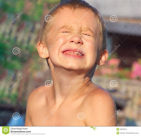 Child Boy Making Sore Crying Faces Showing Calfs Teeth