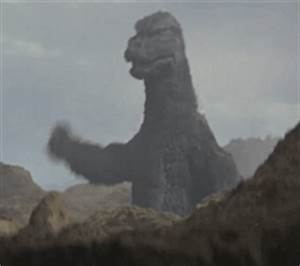 Godzilla Brush Shoulders GIF - Find & Share on GIPHY