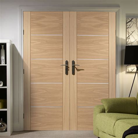 Flush Door by Portici Oak Flush Door Pair With Aluminium Inlay Prefinished