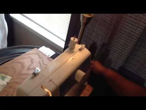 with the wind ls ls 2125 sewing machine how to wind bobbin thread