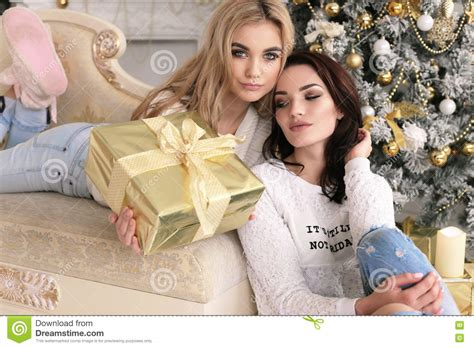 Beautiful Girls In Cozy Home Clothes Celebrating New Year