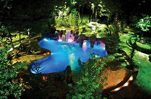 This enchanting lagoon-style pool features three ...