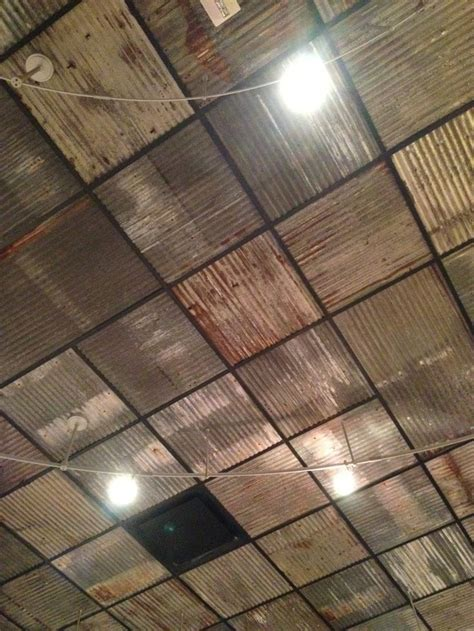 Replace boring ceiling tiles with rusty corrugated metal