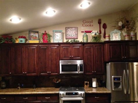 decorate  top  cabinets  vaulted ceiling