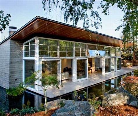 green home designs sustainable house by the pond freshome com
