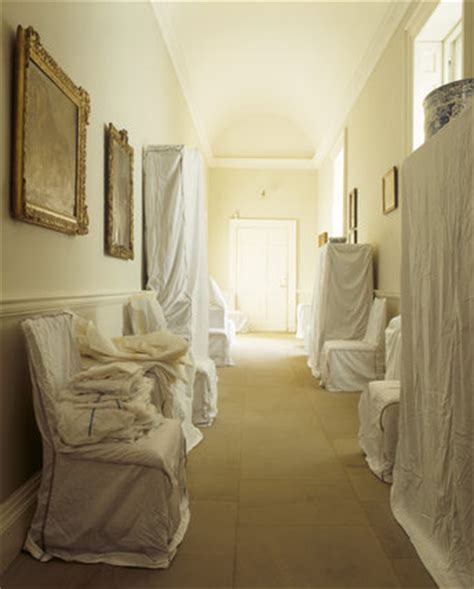 dust sheets cover the furniture in the corridor