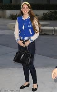 lana del rey wears cute varsity jacket  la lakers game