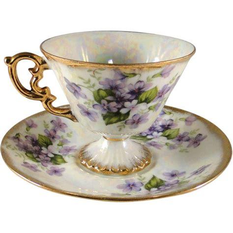 iridescent ucagco february violets cup  saucer set