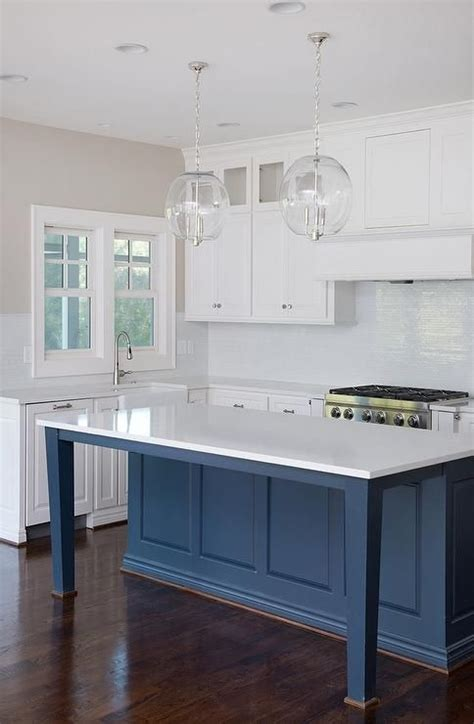 white  blue kitchen boasts  pair  clear glass