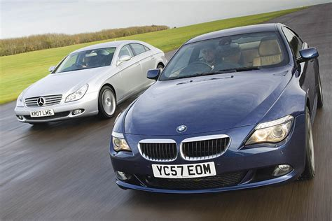 mercedes vs bmw ads mercedes cls vs bmw 6 series coupe auto express