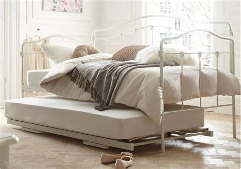 Pop Up Trundle Beds by Furniture Vintage Iron Bed With Pop Up Trundle Placed On