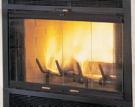 fireplace with glass doors monessen pewter bi fold glass fireplace doors with black