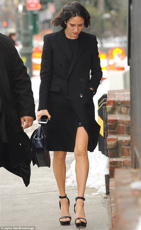 jennifer connelly street style jennifer connelly flashes trim legs in black coat and