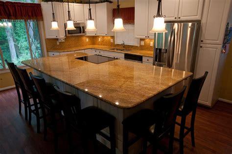 madura gold  white cabinets traditional kitchen