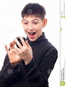 Surprised Teenage Boy Looking At His Smart Phone Stock ...
