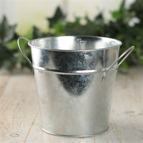 Made with durable corrosion resistant galvanized steel. Galvanized Metal Bucket Planter - Baskets, Buckets, & Boxes - Home Decor