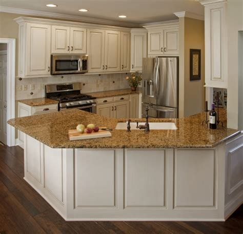 white kitchen cabinets with brown countertops top 29 nice pictures white kitchen cabinets granite 734 | This White Kitchen Cabinets With Brown Granite Countertops is a nice white kitchen cabinets granite countertop 645x621