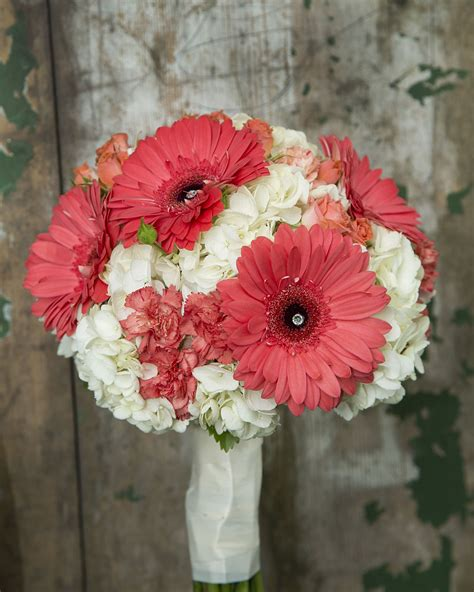 coral gerbera carnations and spray roses with a