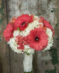 Coral gerbera, carnations and spray roses with a ...