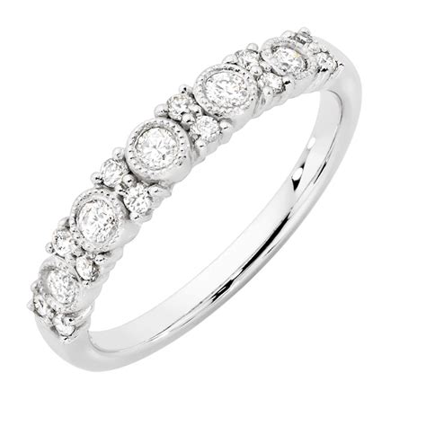 wedding band with 1 3 carat tw of diamonds in 10ct white gold