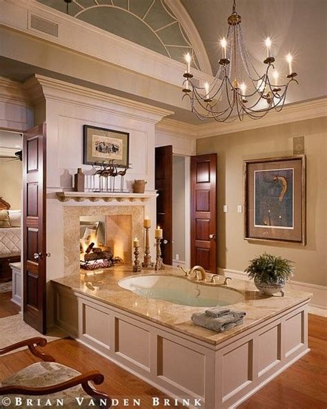 island tub    fireplace open  master suite
