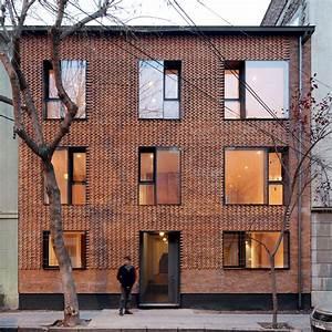 MAPA updates Chilean housing block with textured brick ...