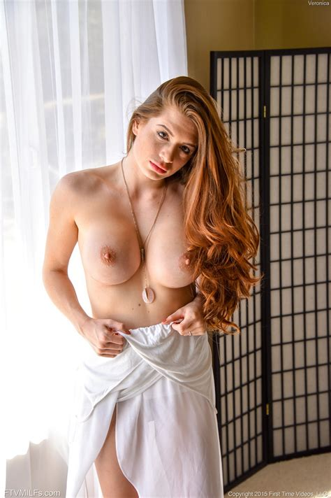 Sexy Redhead Veronica Flaunting Her Huge Tits And