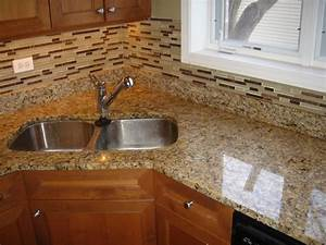 giallo ornamental granite countertop and matching glass With granite countertops and backsplash pictures