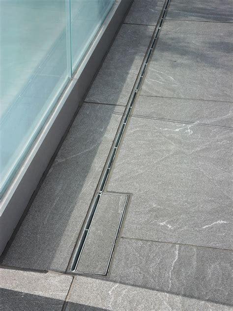 decorative drain covers enhance surrounding concrete