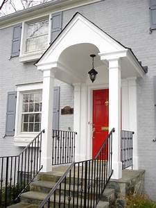 Classic White Columned Portico And Wrought Iron Handrail