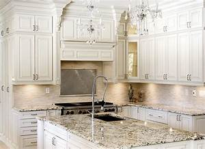 How to paint your kitchen cabinets antique white new for Kitchen colors with white cabinets with wall metal art contemporary