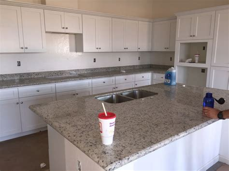 white dallas granite white shaker cabinets kitchen