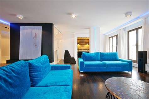 light blue couch living room city center apartment designed by hola design located in
