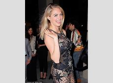 Kate Upton suffers wardrobe malfunction as she parties in