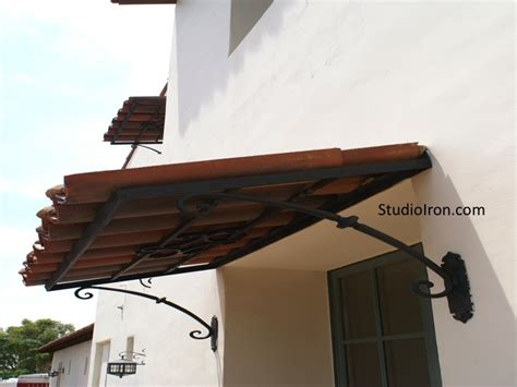tiled roof  iron awning spanish patio spanish style homes spanish style