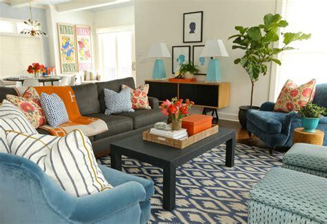 black sofa with orange hermes blanket transitional living room