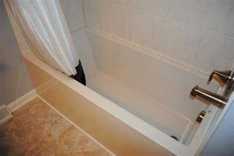 vinyl flooring around bathtub mirabelle soaker tub vinyl floor porcelain tile traditional bathroom other metro by