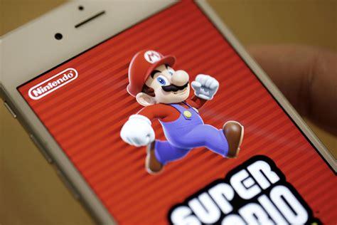nintendo promises  mobile games   toronto star