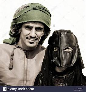 Bedouin Man In Green Turban And Masked Woman In Black ...