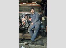 my hubby Sexy mechanic 69 Chevy suburban open engine