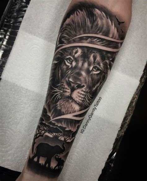 mens forearm sleeve tattoo lion  elephant silhouette