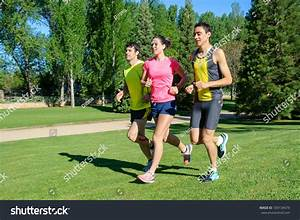 Young Athletes Running Group People Jogging Stock Photo ...