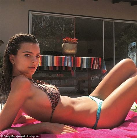 Emily Ratajkowski flaunts ample cleavage in sexy snaps on ...